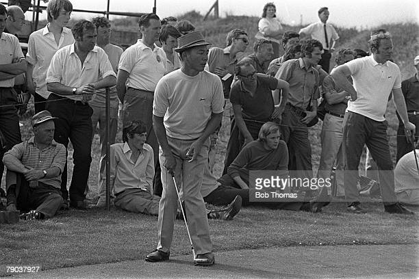 Sport, Golf, British Open Championship, Royal Birkdale, England Taiwan's Mr Lu watches a putt anxiously on the green