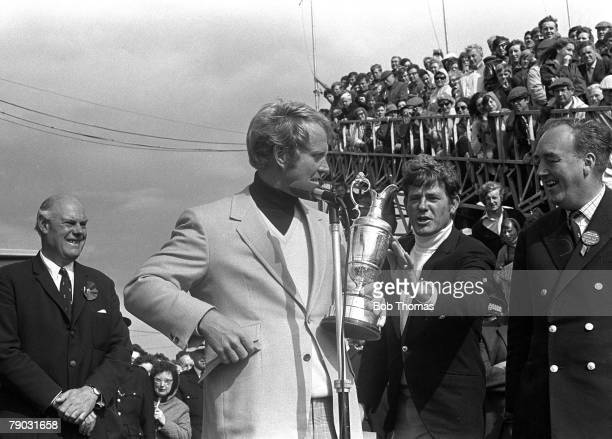 Sport Golf British Open Championship St Andrews Scotland A disappointed Doug Sanders touches the Claret Jug trophy held by the champion Jack Nicklaus