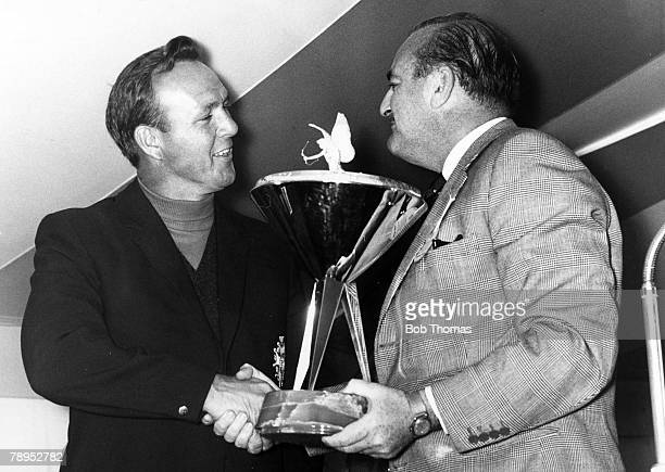 October 1964 Piccadilly World Matchplay Championship USA's Arnold Palmer left receives the Championship trophy