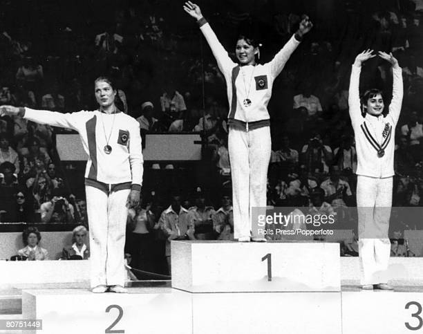 Sport Gymnastics 1976 Olympic Games in Montreal Floor Exercises Podium leftright Ludmila Tourischeva Nelli Kim both Russia and Nadia Comanechi Romania