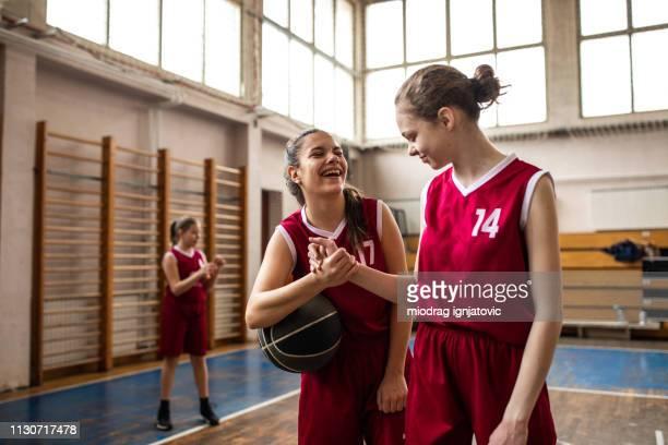 sport handshaking between teenage basketball players - between stock pictures, royalty-free photos & images