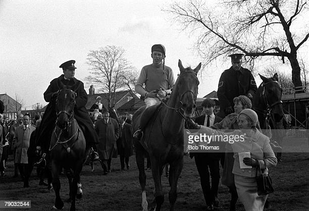 Sport Horse Racing The Grand National Aintree Liverpool England 30th March 1968 The horse Red Alligator ridden by jockey Brian Fletcher is led into...