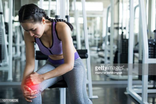 sport injury - human knee stock pictures, royalty-free photos & images