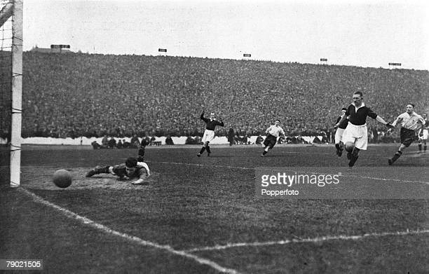 Sport, International Football, Hampden Park, Glasgow, Scotland, 28th March 1931, Scotland 2 v England 0, Scotland goalkeeper Thomson pushes a shot...