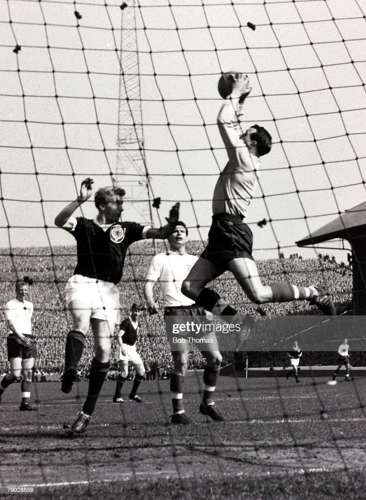 Sport, International Football, Home Championship, Hampden Park, Glasgow, 14th April 1962, Scotland 2 v England 0, Attendance 132,441, England goalkeeper Ron Springett leaps to take the high ball with Scotland forward Denis Law challenging