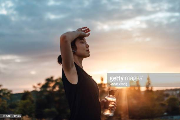 sport lady drinking water after daily training - care stock pictures, royalty-free photos & images