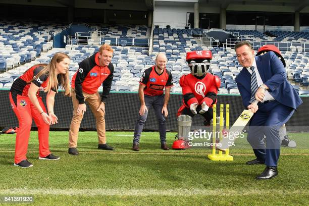 Sport Minister John Eren plays cricket with Sophie Molineux Andrew McDonald and Tim Ludeman of the Renegades and the Renegades mascots during a...