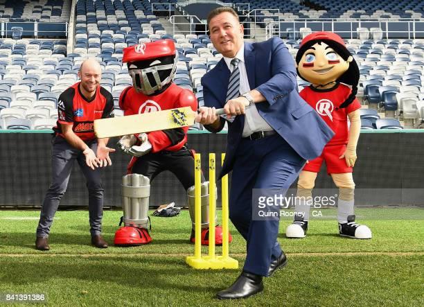 Sport Minister John Eren plays cricket with Tim Ludeman of the Renegades and the Renegades mascots during a Melbourne Renegades Big Bash League media...