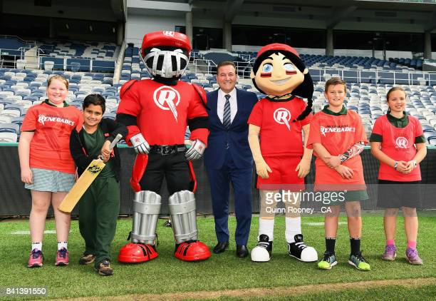 Sport Minister John Eren poses with school kids and the Renegades mascots during a Melbourne Renegades Big Bash League media opportunity at Simonds...