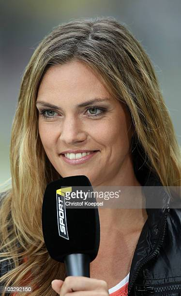 Sport moderator Julia Scharf of Sport 1 television channel looks on during the Derby Cup 2010 match between Bayer Leverkusen and Fortuna Duesseldorf...