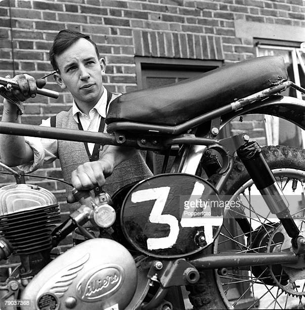 Sport Motor Cycling England British motor cyclist and racing driver John Surtees is pictured repairing one of his bikes