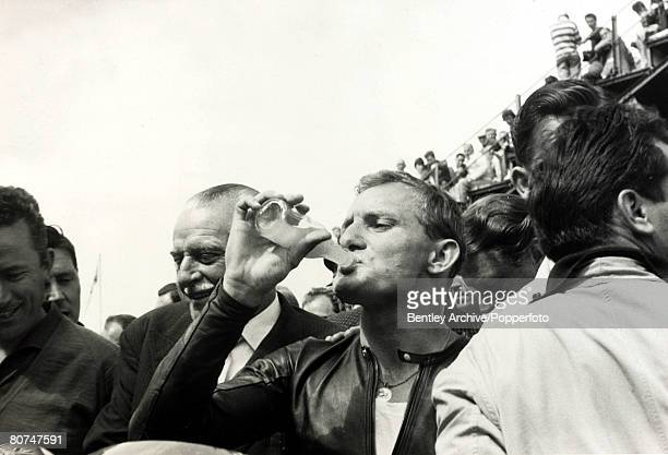 Sport, Motor Cycling, pic: 14th June 1963, Britain's Mike Hailwood enjoys a victory drink at the end of Tourist Trophy race at the Isle of Man TT,...