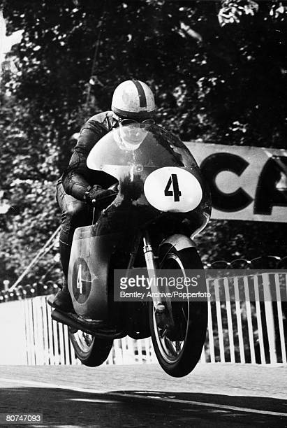 15th June 1960 British motor cycle ace John Surtees pictured at Ballaugh Isle of Man riding in the 350 cc Junior TT race