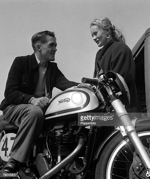 Sport Motor Cycling Ray Amm the winner of the 1953 Senior and Junior TT races at the Isle of Man is pictured on his Norton motorcycle talking to his...
