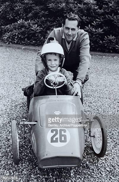 Sport Motor Racing Australian Racing driver Jack Brabham with his five year old son Gary who is sitting in a small model race car