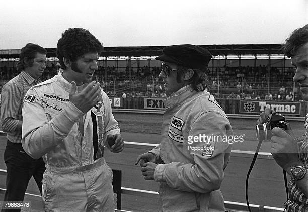 Sport Motor Racing British Grand Prix Silverstone England 12th July 1973 South Africas Jody Scheckter chats with Scotlands Jackie Stewart before the...