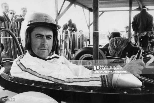 Sport Motor Racing England April 1966 Australian Racing driver Jack Brabham sits in a car at the Goodwood Motor Racing meeting