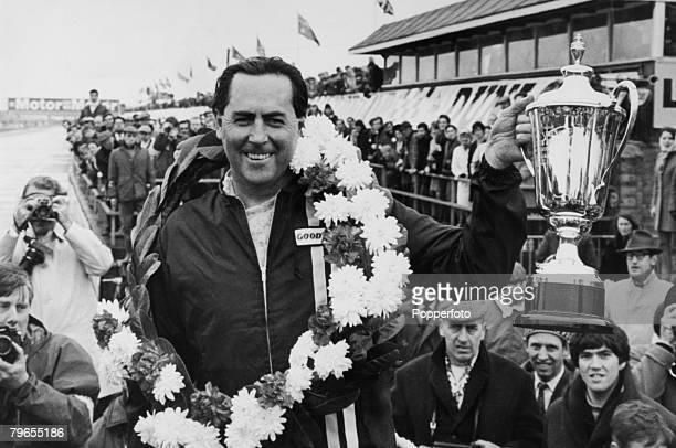Sport Motor Racing England March 1969 Australian Racing driver Jack Brabham holds aloft the trophy after winning the International Trophy Race at...