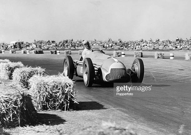 13th May 1950 European Grand Prix at Silverstone Argentinian driver Juan Manuel Fangio pictured in his Alfa Romeo before he had to retire with oil...