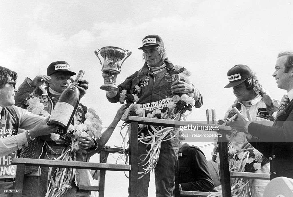 Sport Motor Racing. Formula One. pic: 16th July 1977. British Grand Prix at Silverstone. The Grand Prix winner, Britain's James Hunt, centre with his old rival Niki Lauda, who came second, left and third placed Gunnar Nilsson of Sweden. : News Photo