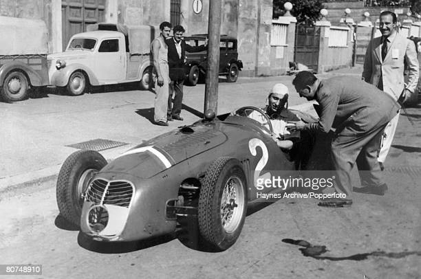 1949 Road Race Rome Italy Argentinian driver Juan Manuel Fangio pictured in his Maserati car during a stop in the race Juan Fangio won the world...