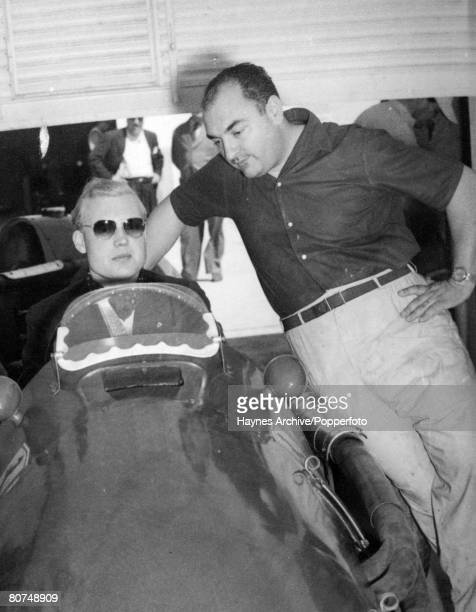 1954 British racing driver Mike Hawthorn wearing dark glasses at the wheel chatting with Ferrari driver JFGonzalez of Argentina Mike Hawthorn won the...