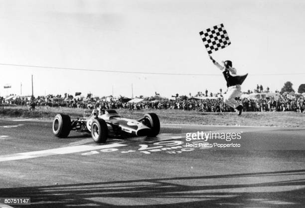 3rd October 1967 American Grand Prix at Watkins Glen Great Britain's Jim Clark races past the leaping Tex Hopkins and the checkered flag to win the...