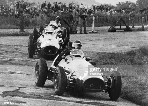 5th August 1953 German Grand Prix at the Nuerburgring British racing driver Mike Hawthorn in a Ferrari leads during the race ahead of the eventual...