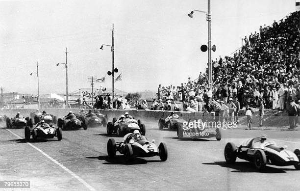 5th August 1953 Portuguese Grand Prix at Lisbon Australia's Jack Brabham right in a Cooper leads at the start with no 4 a CooperClimax driven by...