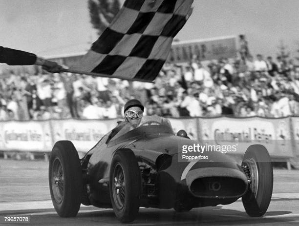 6th August 1957 German Grand Prix at the Nurbuergring Argentinian driver Juan Manuel Fangio pictured winning the race which gave him an unbeatable...