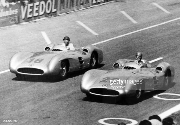 6th July 1954 French Grand Prix at Rheims Argentinian driver Juan Manuel Fangio pictured in his Mercedes with German driver Karl Kling also Mercedes...