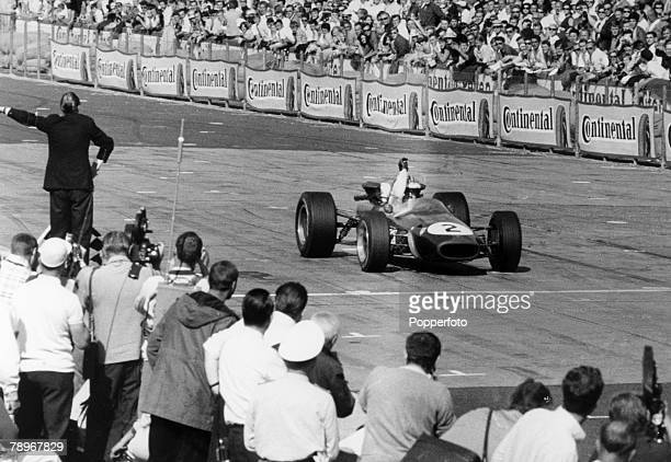 Sport, Motor Racing, Formula One, pic: 8th August 1967, German Grand Prix at the Nuerburgring, New Zealand driver Denny Hulme crosses the line in his...