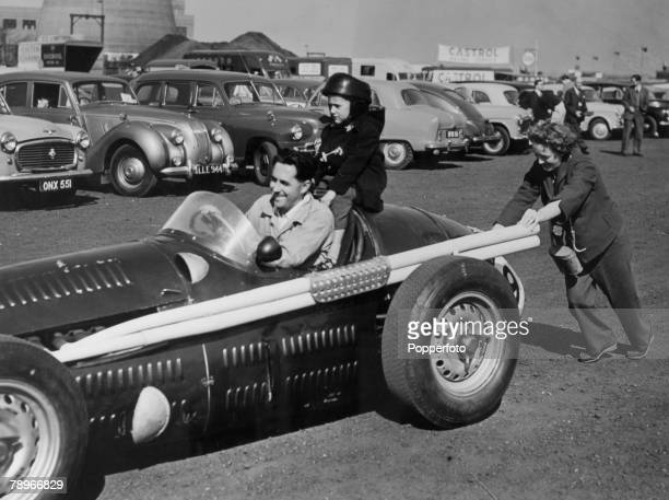 circa 1959 Australian driver Jack Brabham gets a push from his wife as his son Geoffrey sits behind the driver Australia's Jack Brabham was a three...