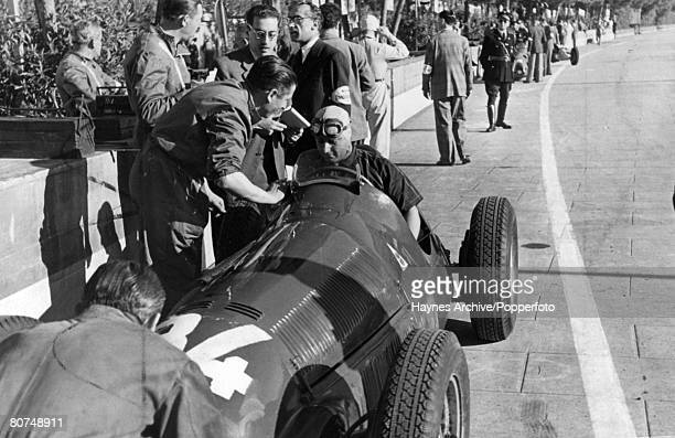 June 1950 Monaco Grand Prix at Monte Carlo Argentinian driver Juan Manuel Fangio pictured in his car during a stop in the race Juan Fangio won the...