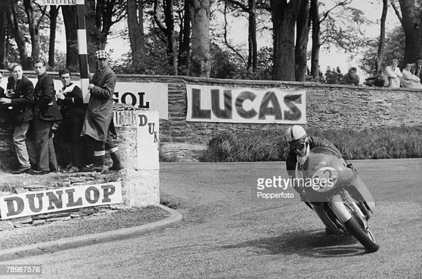 Sport Motor Racing Isle of Man Junior TT Race June 1958 Spectators watch as John Surtees takes a bend at Governors Bridge on a four cylinder MV...