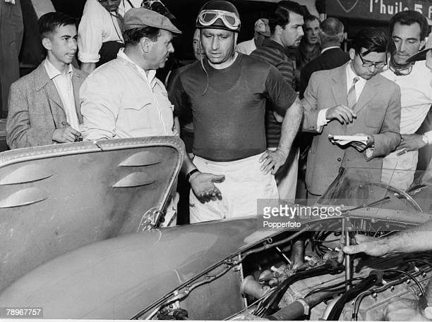 Sport Motor Racing Le Mans France June 1957 Racing driver Juan Manuel Fangio talks by the side of a car before the start of the 24 hour race