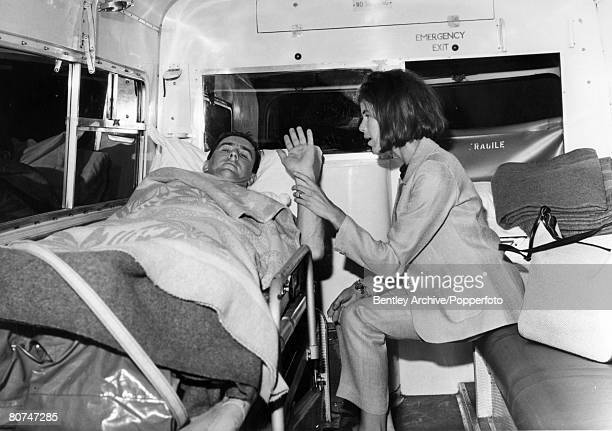 13th June 1966 London Great Britain's Jackie Stewart with is wife Helen as he is transferred by ambulance to St Thomas' Hospital to recover from his...