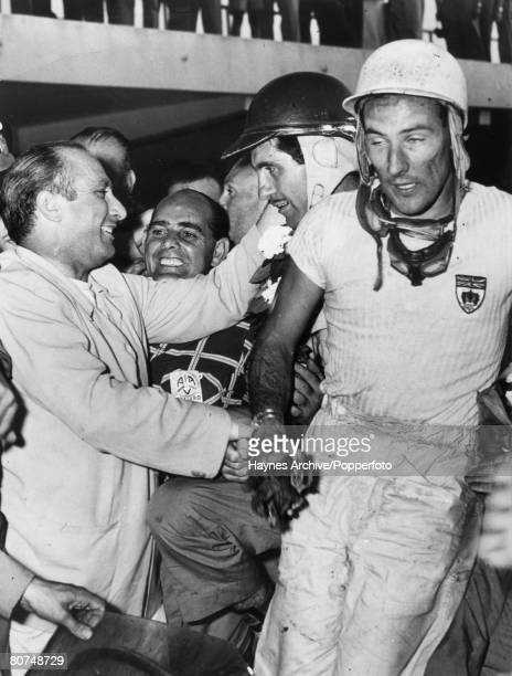 1956 Argentina's Juan Fangio left congratulates Carlos Henditeguy centre and Stirling Moss after a Grand Prix race in Buenos Aires