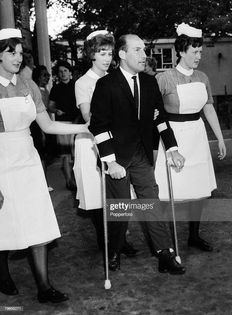 Sport, Motor Racing, pic: 22nd June 1962, British racing driver Stirling Moss, born 1929, is pictured leaving the Atkinson Morley Hospital, Wimbledon, after recovering from his Easter Monday crash at Goodwood, Stirling Moss was among the world's elite of  : News Photo