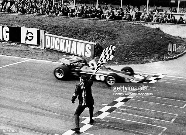 23rd March 1970 Daily Mail Race of Champions at Brands Hatch British driver Jackie Stewart wins the race in a March 701 as he takes the checkered...