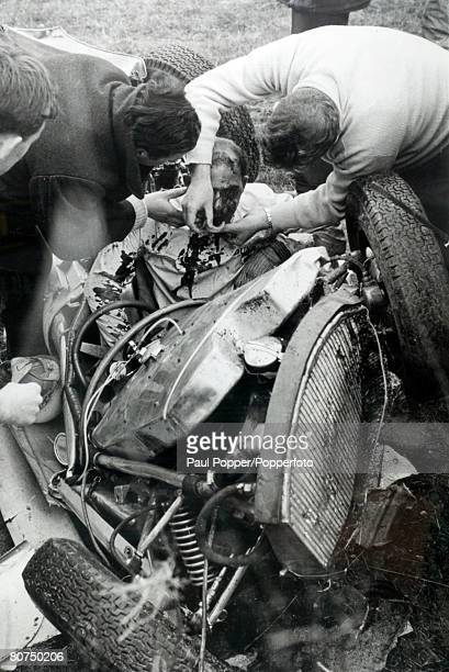 24th April 1962 Goodwood England British racing driver Stirling Moss born 1929 pictured in his wrecked car after crashing at the Glover Trophy Race...