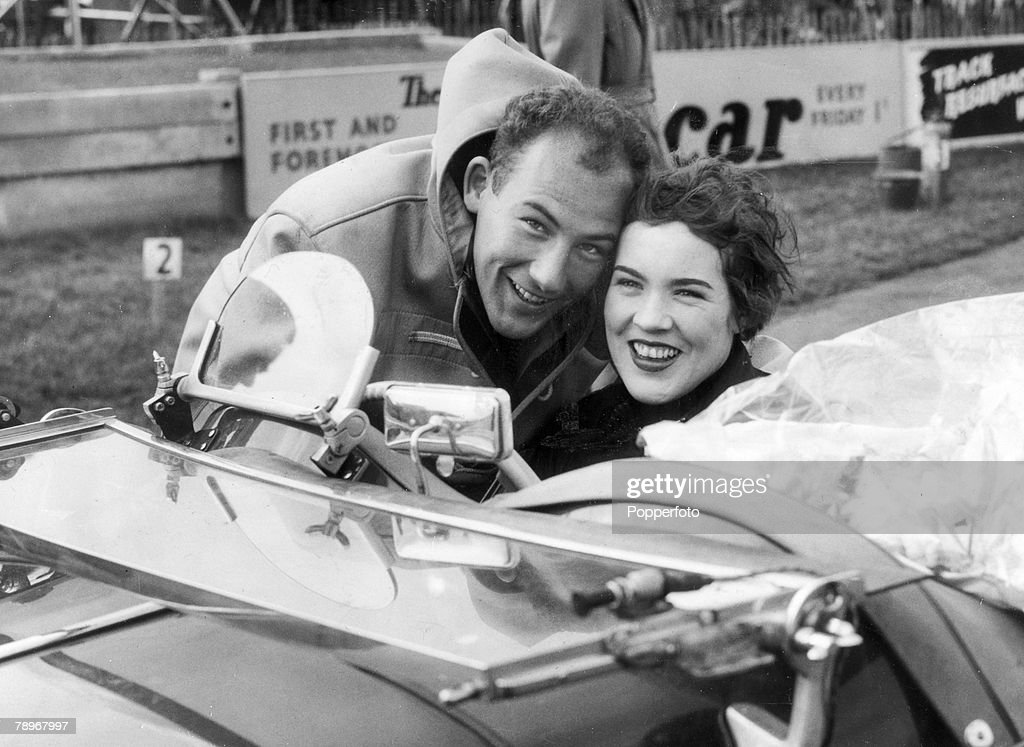 Sport. Motor Racing. pic: 27th March 1955. Sports Car Meeting at Goodwood, Sussex. British racing driver Stirling Moss has a congratulatory hug for his sister Pat Moss after she had won the 5 lap handicap race. Stirling Moss was among the world's elite of : News Photo