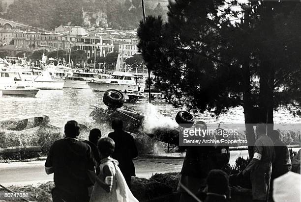 9th May 1967 Italy's Lorenzo Bandini in a Ferrari crashes and the car begins to roll over after hitting the straw bales after losing control at the...