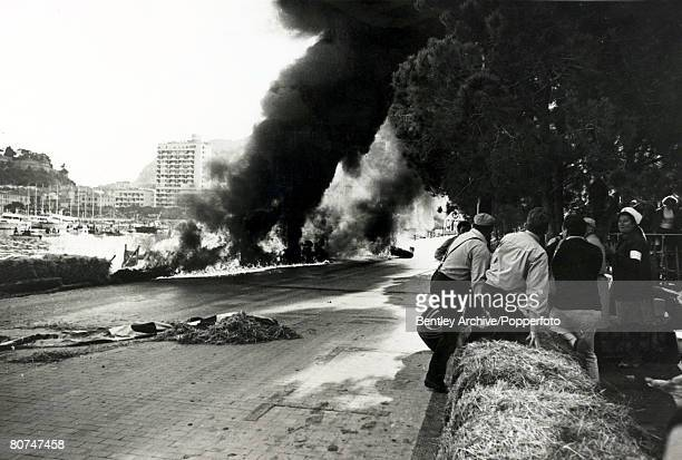 9th May 1967 Italy's Lorenzo Bandini in a Ferrari has crashed and his car becomes a fireball after hitting the straw bales after losing control at...