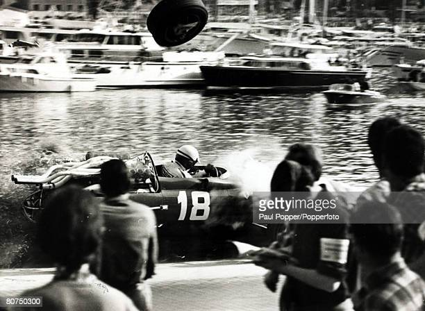 9th May 1967 Italy's Lorenzo Bandini in a Ferrari crashes after losing control at the chicane with a wheel flying throught the air and the car about...