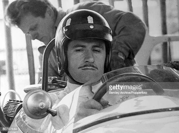 April 1966 British driver Graham Hill pictured at Goodwood Sussex at the Easter Monday meeting Graham Hill was Formula One world champion twice in...