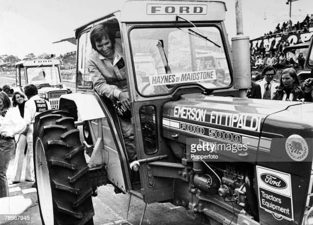 August 1972 Brands Hatch England The Rothmans 50000 Race Emerson Fittipaldi Brazil about to race with other Grand Prix drivers in the Ford tractor...