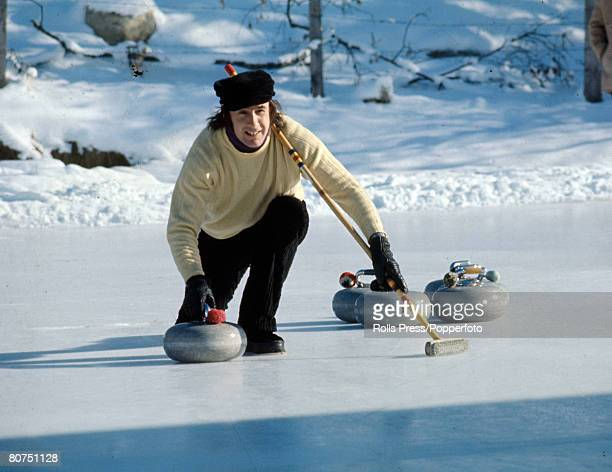 Gstaad Switzerland British racing driver Jackie Stewart playing the sport of curling during a break in Switzerland Jackie Stewart a Scot was Formula...