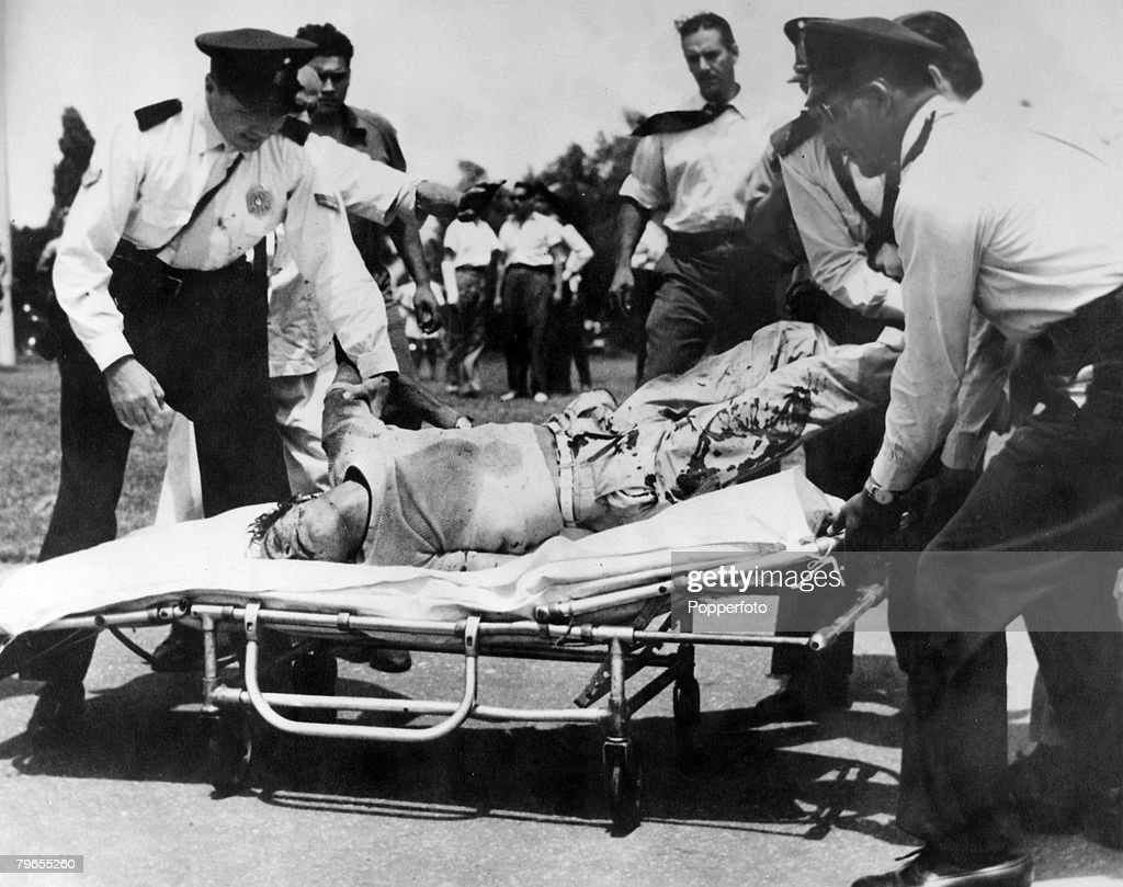 Sport, Motor Racing, pic: January 1958, 100 Km Race in Buenos Aires, Driver Jorge Magnasco is carried away from a crash, as he lies motionless on a stretcher, Magnasco lost his life in the crash, when his Maserati car overtuned : News Photo