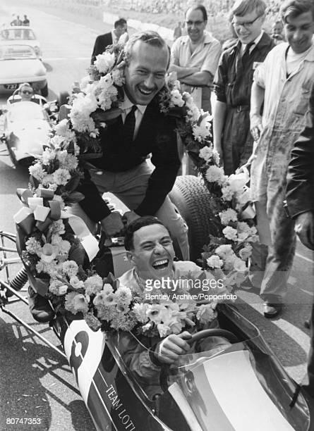 Sport Motor Racing September 1963 Brands Hatch England Driver Jim Clark laughing with Colin Chapman designer at Lotus Clark won the World...